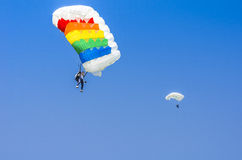 Parachute jumpers in the sky. Two female parachutist in flight with blue sky in the background at the Red Bull Ordinul Smaranda competition on June 7, 2014 in Stock Photos