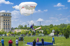 Parachute landing. Parachutist landing on the ground at the Red Bull Ordinul Smaranda competition on June 7, 2014 in Bucharest, Romania Royalty Free Stock Photography