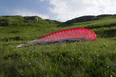 Parachute lying on mountain slope Stock Photo