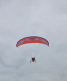 Parachute with a motor in a sky. Stock Image