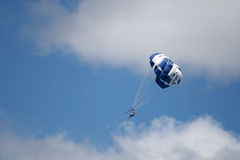 Parachute,New Zealand. Parachutist with blue parachute on the Taupo Lake,New Zealand Stock Image