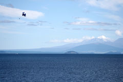 Parachute,New Zealand. Parachutist with blue parachute on the Taupo Lake,New Zealand Stock Photography