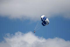 Parachute,New Zealand. Parachutist with blue parachute on the Taupo Lake,New Zealand Stock Photos