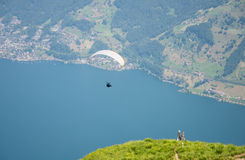 Parachute is over the lake. This is a photo of parachute fly over the lake Stock Photography