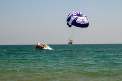 Parachute over the sea Royalty Free Stock Photo