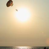 Parachute. Parachutist enjoying the parasailing tour above the sea Stock Photography