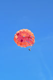 A parachute with the person in the sky Stock Photography