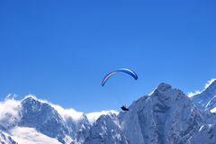 Parachute in the sky. Nice parachute in the blue rock sky Royalty Free Stock Images