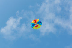 Parachute in the sky over the sea Stock Images
