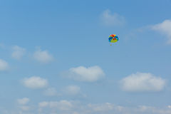 Parachute in the sky over the sea Stock Photography