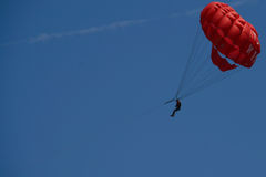Parachute in the sky. Parachuting in the sky, towing by a boat Royalty Free Stock Images
