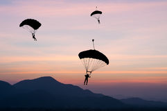Parachute. The parachute at sunset silhouetted Stock Photos