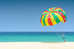 Parachute for tourist on sand beach Royalty Free Stock Photo