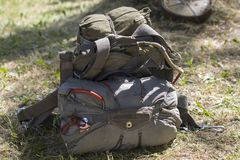 Assembled main and reserve parachute parachute lies on the ground stock photography