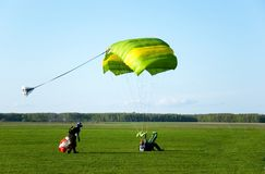 Parachuter. The man ready for landing with parachute Stock Photo