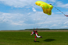 The parachuter. The man ready for landing with parachute Royalty Free Stock Photos