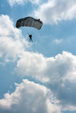 Parachuter. On blue sky with clouds Royalty Free Stock Images