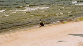 Parachuter above the Baltic sea in Lithuania. Parachuter above the Baltic sea. Flying with the parachute Stock Image