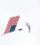 Parachuter carrying the American flag royalty free stock photos