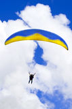 Parachuter descending with instructor. Against blue sky Stock Image