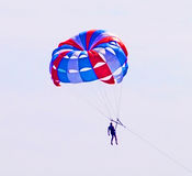 Parachuter descending with a parachute Royalty Free Stock Images