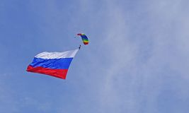 Parachuter with flag. The parachuter with russian flag in the sky Royalty Free Stock Image