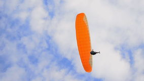 Parachuter flying in air stock video