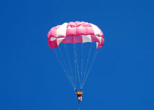 Parachuter. Man on a parachute against the blue sky Royalty Free Stock Photos