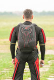 Parachuter preparing for jumping. Parachuter in aeroclub Zagreb preparing for jumping event, packing and checking equipment, on a field airport Lucko in Zagreb Royalty Free Stock Photo