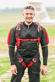Parachuter preparing for jumping. Parachuter in aeroclub Zagreb preparing for jumping event, packing and checking equipment, on a field airport Lucko in Zagreb Royalty Free Stock Photography