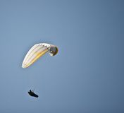 Parachuter in sky. Parachuter flying in air with blue sky Royalty Free Stock Photos