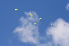 Parachuters. Skydivers descending with parachutes deployed Royalty Free Stock Photography