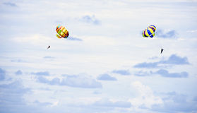 Parachutes on blue sky Royalty Free Stock Photography