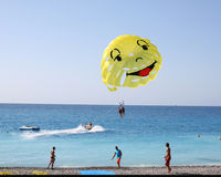 Parachutes are excitig on the French riviera. A typical French Riviera scene with views from Prom des Anglais. A boat towig a motor boat Royalty Free Stock Images