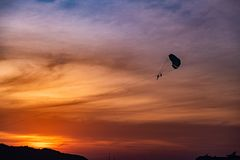 Parachutes in the seaside sunset royalty free stock photos