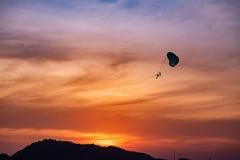 Parachutes in the seaside sunset stock photos
