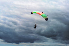 Parachuting. Two people flying high on sky background Stock Images