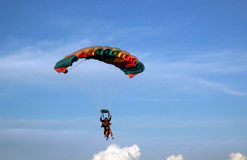 Parachuting. Two men doing parachuting on the sky royalty free stock image