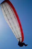 Parachuting. The person on a paraplane flies against the sky Stock Photography