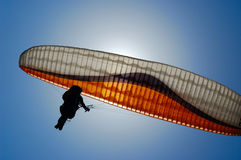 Parachuting. The person on a paraplane flies against the sky Royalty Free Stock Photo