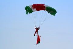 Parachuting. A parachutist gliding down towards the drop zone Stock Photos
