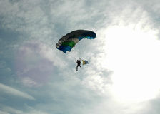 Parachuting - back lit Royalty Free Stock Photos