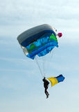 Parachuting - back lit Stock Photo