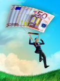 Parachuting businessman Stock Images