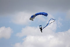 Parachuting among the clouds Royalty Free Stock Photo