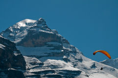 Parachuting high in the mountains. Parachuting with the view on Jungfrau stock photography