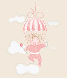 Parachuting Little Girl with Lollipop Stock Photography