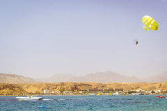 Parachuting over a sea, towing by a boat in Sharm El Sheikh Royalty Free Stock Images