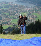 Parachuting. A parachuter is getting ready for his jump from Wallenberg, high above Tegernsee. Lake Tegern (Tegernsee), Bavaria, from Wallenberg with Rottach Royalty Free Stock Photo