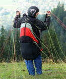 Parachuting. A parachuter is getting ready for his jump from Wallenberg, high above Tegernsee. Lake Tegern (Tegernsee), Bavaria, from Wallenberg with Rottach Royalty Free Stock Photography